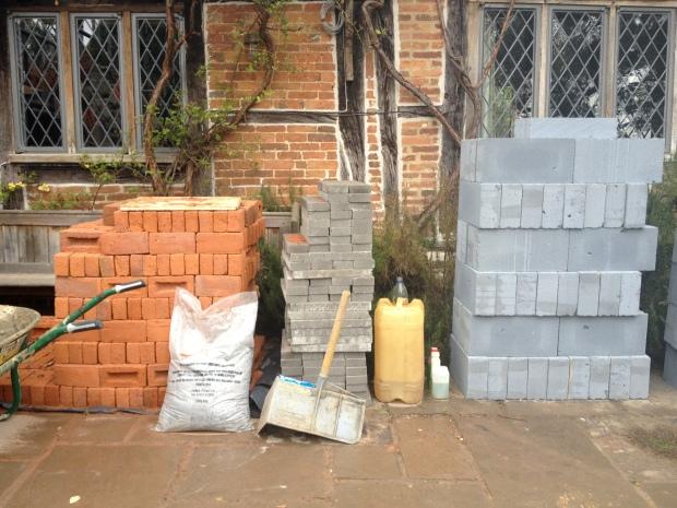piles of bricks stacked in garden